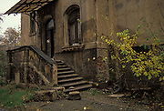 A year after the fall of the Berlin Wall and the end of the Communist Eastern Bloc, are the partially-collapsed ballustrade and porch of a semi-derelict German house, on 4th November 1990, in Leipzig, Germany.