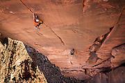 Kevander Baldwin puts up a first ascent in Kane Creek, Utah, naming it Dawn of the Desert Rat.