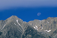 Moon sets over the crest of the Eastern Sierra near Independence, Inyo County, CALIFORNIA