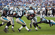 CHARLOTTE, NC - NOVEMBER 7:  The Carolina Panthers defense gang tackles running back Amos Zereoue #28 of the Oakland Raiders at Bank of America Stadium on November 7, 2004 in Charlotte, North Carolina. The Raiders defeated the Panthers 27-24. ©Paul Anthony Spinelli  *** Local Caption *** Amos Zereoue