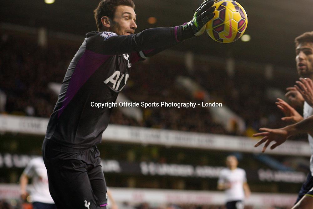 20 December 2014 Premeir League Football - Tottenham Hostpur v Burnley;  Tottenham goalkeeper Hugo Lloris dives to punch the ball.<br /> Photo: Mark Leech.