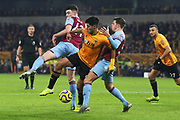 Raul Jimenez competes with Aaron Cresswell and Declan Rice for the ball during the Premier League match between Wolverhampton Wanderers and West Ham United at Molineux, Wolverhampton, England on 4 December 2019.