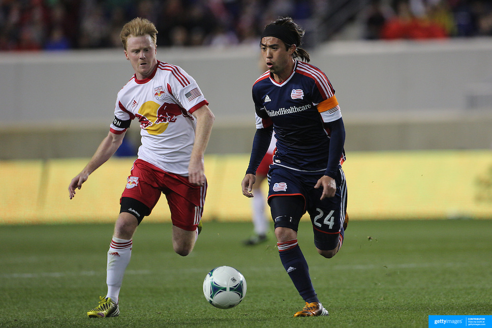 Lee Nguyen, (right), New England Revolution, challenged by Dax McCarty, New York Red Bulls, during the New York Red Bulls V New England Revolution, Major League Soccer regular season match at Red Bull Arena, Harrison, New Jersey. USA. 20th April 2013. Photo Tim Clayton