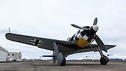 Focke Wulf FW190 replica being pushed out of hangar.