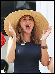 Image licensed to i-Images Picture Agency. 31/07/2014. Goodwood. United Kingdom. Carol Vorderman celebrates a winner  at Ladies Day at Glorious Goodwood.  Picture by Stephen Lock / i-Images