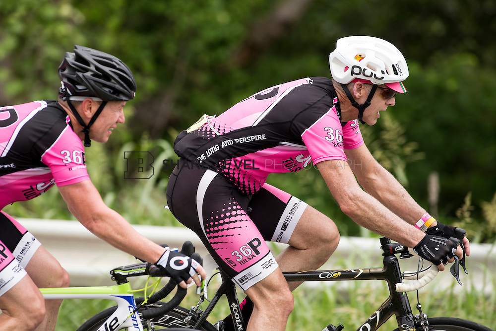 6/13/15 11:53:38 AM -- Riders pass by on their way to the top of the hill climb during the Saturday Grand Fondo Hill Climb at the Tulsa Tough rides. <br /> <br /> Photo by Shane Bevel