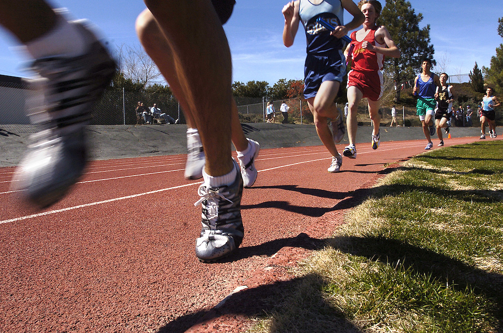 High School Boys take their second lap during a relay race at Antelope Valley College during Herb Wyre Relays.  LACEFIELD/Valley Press Mar 4, 2006