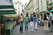 Europe, Slovakia, capitol city - Bratislava.  Girlfriends stolling through Michalska pedestrian street in central Bratislava.