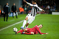 23.10.12. Copenhagen, Denmark. UEFA Champions League Group E, FC Nordsjaelland  1 vs Juventus 1 at the Parken Stadium. Vucinic (L) of Juventus fights for the ball with Stokholm (R) of FC Nordsjaelland during the UEFA Champions League. Photo: © Ricardo Ramirez..
