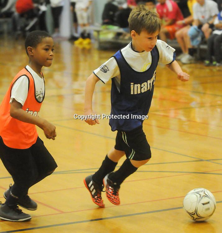 Christian Mullins dribbles past Robert Robinson during the Wilmington Hammerheads' Youth Outreach Indoor Friendly Tournament Sunday January 11, 2015 at the MLK Center in Wilmington, N.C. (Jason A. Frizzelle)