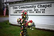 "A flower cross memorial is set up outside the Oso Community Chapel for mudslide victims in Oso, Washington March 27, 2014. Rescue teams on Thursday clawed through the moon-like surface left by a massive mudslide in Washington state that killed at least 25 people, searching for those still missing, and the community prayed for ""one little miracle.""  REUTERS/Rick Wilking(UNITED STATES)"