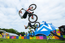 Edinburgh, Scotland, UK. 2 August 2019. Professional Trials riders Danny MacAskill and Duncan Shaw perform tricks on the Meadows. Danny MacAskill's Drop & Roll Live is a main highlight of this year's Underbelly Circus Hub programme.  Iain Masterton/Alamy Live News