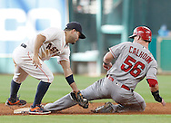 Jun 22, 2016; Houston, TX, USA; Los Angeles Angels right fielder Kole Calhoun (56) steals second base while Houston Astros designated hitter Jose Altuve (27) is late with the tag in the ninth inning at Minute Maid Park. Astros won 3 to 2. Mandatory Credit: Thomas B. Shea-USA TODAY Sports