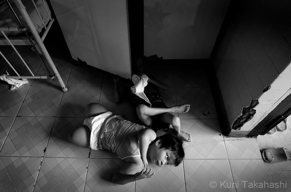 Truong Ngoc Diep, 8, bottom, and Nguyen Minh Vu, 3, lay on the floor at Tu Du Hospital in Ho Chi Minh City, Vietnam. .Many children in the hospital, who are from areas that were heavily sprayed by Agent Orange during the war, suffer mental and physical problems due to exposure to the toxic herbicide..