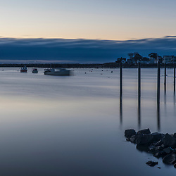 Clouds hug the horizon at dawn in Rye Harbor, New Hampshire.