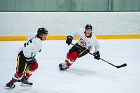 PENTICTON, CANADA - SEPTEMBER 9: Spencer Foo #15 and Mark Jankowski #77 of Calgary Flames skate during morning ice on September 9, 2017 at the South Okanagan Event Centre in Penticton, British Columbia, Canada.  (Photo by Marissa Baecker/Shoot the Breeze)  *** Local Caption ***