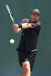 May 24, 2011; Stanford, CA, USA;  Southern California Trojans number 1 singles player Steve Johnson hits a backhand against Virginia Cavaliers number 1 singles player Michael Shabaz (not pictured) during the finals of the men's team 2011 NCAA Tennis Championships at the Taube Tennis Center.