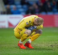 2nd December 2017, Global Energy Stadium, Dingwall, Scotland; Scottish Premiership football, Ross County versus Dundee; Ross County goalkeeper Aaron McCarey in agony after a challenge