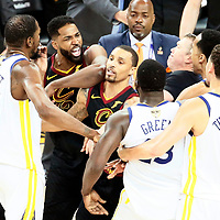 OAKLAND, CA - MAY 31: Tristan Thompson #13 of the Cleveland Cavaliers shouts at Draymond Green #23 of the Golden State Warriors in Game One of the 2018 NBA Finals won 124-114 in OT by the Golden State Warriors over the Cleveland Cavaliers at the Oracle Arena on May 31, 2018 in Oakland, California. NOTE TO USER: User expressly acknowledges and agrees that, by downloading and or using this photograph, User is consenting to the terms and conditions of the Getty Images License Agreement. Mandatory Copyright Notice: Copyright 2018 NBAE (Photo by Chris Elise/NBAE via Getty Images)