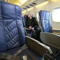 Hannah Stanley of Jackson gets her first look of the interior of the ERJ-135 that will begin service for Contour Airlines serving from Tupelo to Nashville.