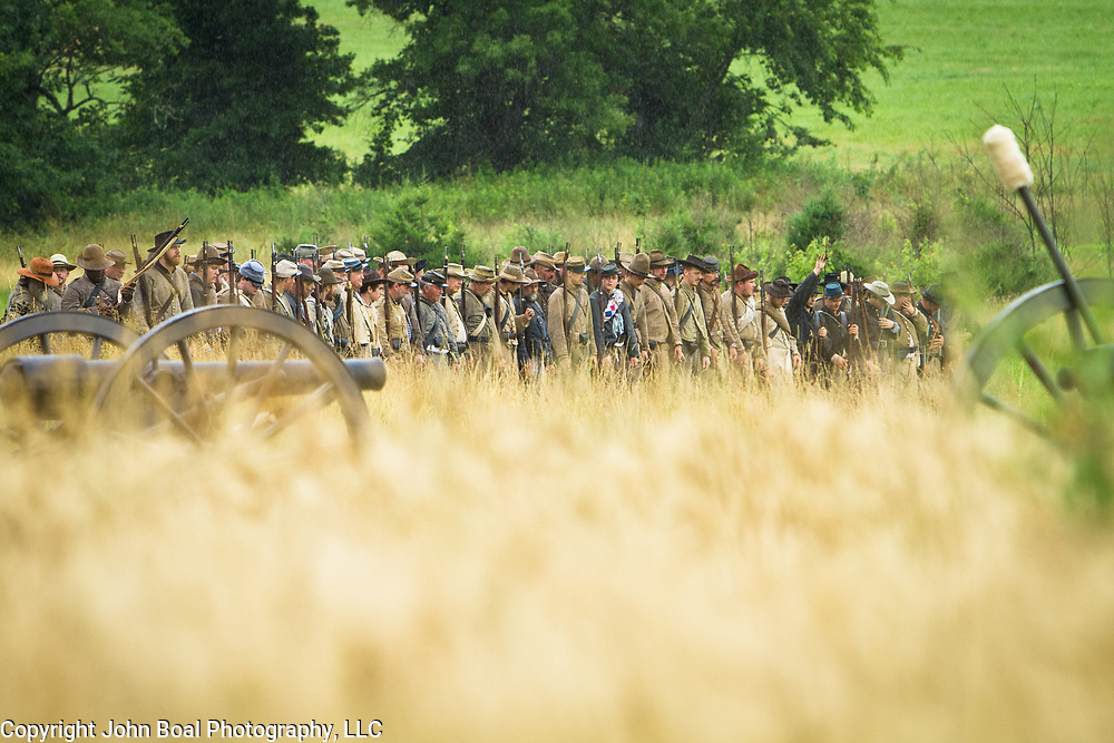 Confederate living historians prepare to fire rifles during an artillery and skirmish demonstration, during the Sesquicentennial Anniversary of the Battle of Gettysburg, Pennsylvania on Wednesday, July 3, 2013.  The Battle of Gettysburg lasted from July 1-3, 1863 resulting in over 50,000 soldiers killed, wounded or missing.  John Boal Photography