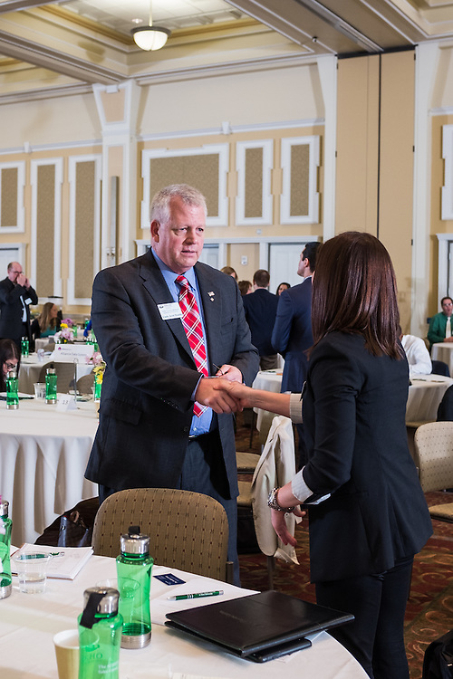 Commander Scott Waddle chats with a student after his talk during Ohio University College of Business Schey Sales Centre Symposium on April 14, 2015.  Photo by Ohio University  /  Rob Hardin