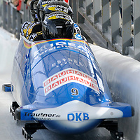 01 March 2009:    The Germany 3 bobsled driven by Thomas Florschuetz with sidepushers Marc Kuehne and Thomas Poege, and brakeman Alexander Metzger finish their 4th run at the 4-Man World Championships competition on March 1 at the Olympic Sports Complex in Lake Placid, NY.  The USA 1 bobsled driven by Steven Holcomb with sidepushers Justin Olsen and Steve Mesler, and brakeman Curtis Tomasevicz won the competition and the World Championship bringing the U.S. their first world championship since 1959 with a time of 3:36.61.