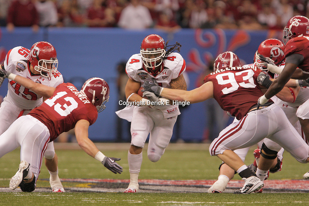 2 January 2009: Utah running back Matt Asiata runs between Alabama defenders Cory Reamer (13) and Bobby Greenwood (93) during a 31-17 win by the Utah Utes over the Alabama Crimson Tide in the 75th annual Allstate Sugar Bowl at the Louisiana Superdome in New Orleans, LA.