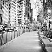 Chicago Riverwalk black and white picture. Photo includes Wrigley Building and Tribune Tower.