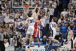 Dixie Heights' Brandon Hatton, right, has his shot contested by Lexington Catholic's Craig Floyd. Hatton had 18 points but his team lost 69-60. Lexington Catholic hosted Dixie Heights in the 2011 PNC/ KHSAA Boys Sweet 16, Wednesday, March 16, 2011.