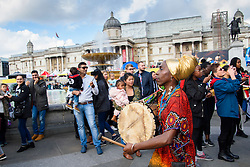 Dancers in a procession during Africa on the Square, an event celebrating  traditions and cultures of the African continent, in Trafalgar Square, London. Picture date: Saturday October 15, 2016. Photo credit should read: Matt Crossick/ EMPICS Entertainment.