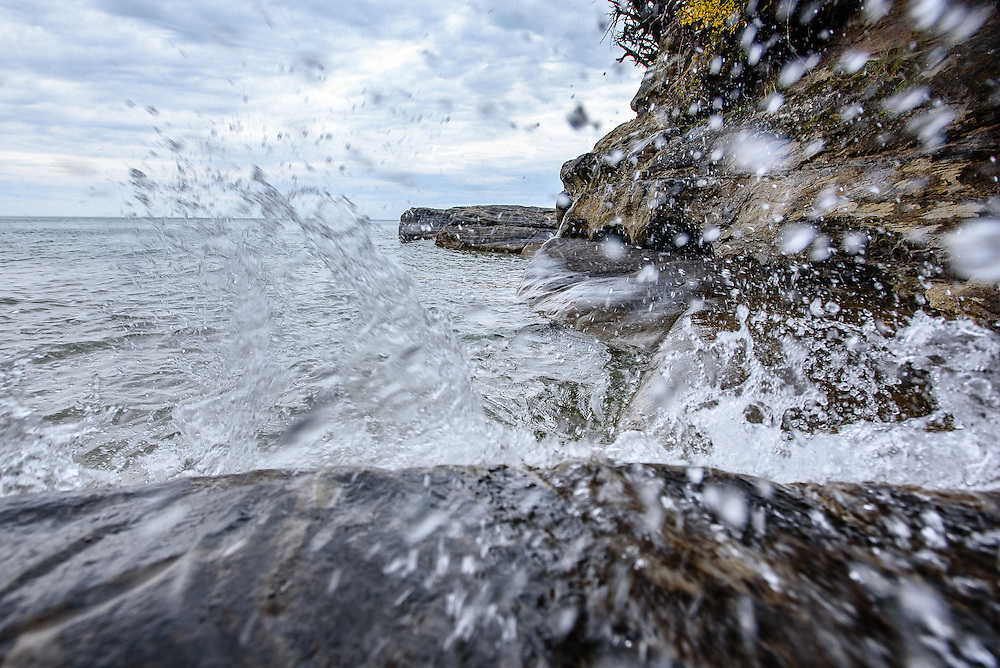 PICTURED ROCKS NATIONAL LAKESHORE - October 2016: Waves splash against the rocks in an area known as the coves in Pictured Rocks National Lakeshore. This is in the Beaver Basin Wilderness Area section of the park and a short 1.5 mile hike from the Little Beaver Lake Campground. Photographer Bryan Mitchell was this years Artist in Residence at Pictured Rocks National Lakeshore in the Upper Peninsula of Michigan from Oct. 1-17, 2016 near Munising, Michigan. (Photo by Bryan Mitchell)