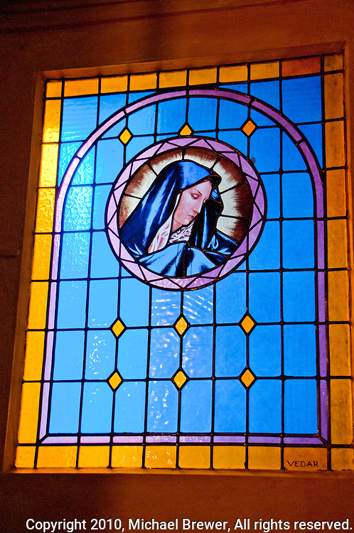Modern stained glass Virgin Mary window in the church in Loco in the Valle Onsernone in Ticino, Southern Switzerland.