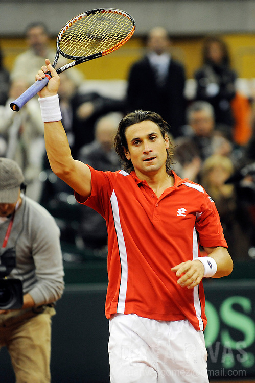 Spain's David Ferrer celebrates his victory against Switzerland's Marco Chiudinelli.. during his Davis Cup World Group first round tennis match, in Logrono, North of Spain, on March 5, 2010. PHOTO/Rafa Rivas