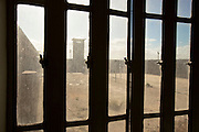 A sombre view through the bars of the prison on Robben Island, Cape Town. Image by Greg Beadle