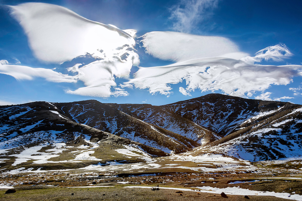 Snowy High Atlas Mountains with beautiful clouds, Morocco.