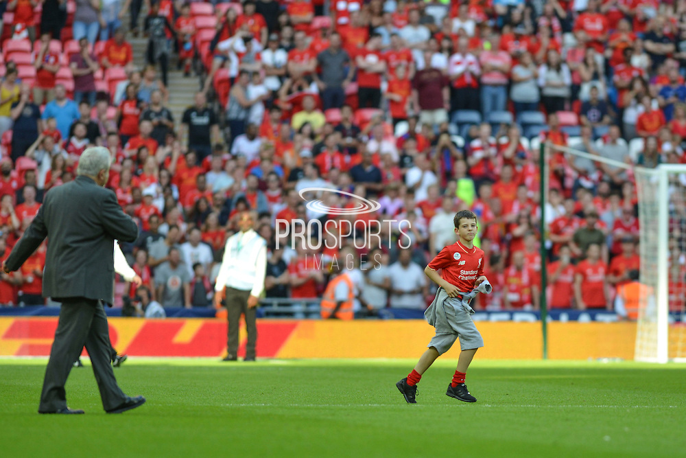 young pitch invader during the International Champions Cup between Liverpool FC and FC Barcelona at Wembley Stadium, London, England on 6 August 2016. Photo by Mark Davies.