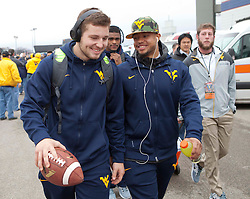 West Virginia quarterback Skyler Howard walks off the bus as he enters the stadium in Memphis, TN for the Liberty Bowl.