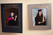 Pictures of Cecileís graduation and master degree are hanging from the wall in her living room on Sunday, 10 June, 2006, in Camden Town, London, England. Cecile, 31, a French woman from Avignon, lives in London since 14 years and is one of the members in the Vampyre Connexion committee. The Vampyre Connexion is the largest and most active of all the vampire groups in the United Kingdom, counting more than 100 members that for years have gathered regularly in London to share their common love for vampires and the Dark side of life. The Connexion raised from the hashes of the Vampyre Society, the first vampire appreciation group in 1995. The group believe in the fantasy of vampires and such creatures and live it to the full. Its  roots are to be found in the legends of Bram Stokerís Dracula. The group prints its own magazine, ëDark Nightsí featuring drawings, poetry, stories, photography and events. All of the members dress very peculiar clothing, and this is a very important part of the life of the group; it is respected with pride, taste and accuracy for the detail. Most like to dress to be elegant in a range of styles from regency to Victorian, some sew their own. In addition members visit art galleries, cemeteries, churches and cathedrals, attend gigs and concerts, and hold their own parties throughout the year, Halloween being the biggest and scariest one. Membership is open to all, the only qualification: being a love of all things Vampyric.**ItalyOut**