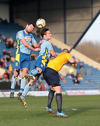 Burton Albion defender Phil Edwards (2) heads clear  - Photo mandatory by-line: Nigel Pitts-Drake/JMP - Tel: Mobile: 07966 386802 08/03/2014 - SPORT - FOOTBALL -  Kassam Stadium - Oxford - Oxford United v Burton Albion - Sky Bet League Two