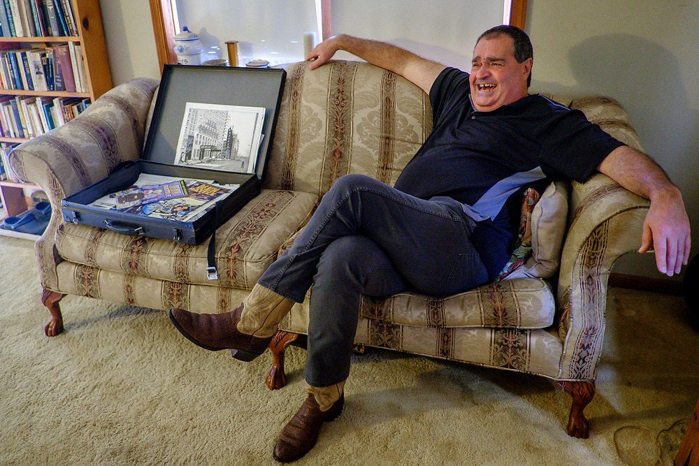 ELKTON, MARYLAND - SEPTEMBER 2: Zane Campbell sits on his couch with some of his artwork in his home in Elkton, Md. on Saturday, September 2, 2017 in Childs, Maryland.  Most Campbells are store owners and artists and musicians, including his Aunt Ola Belle, a star of old-time/bluegrass music in the 60s and 70s, who also ran a country-music park. (Photo by Pete Marovich For The Washington Post)