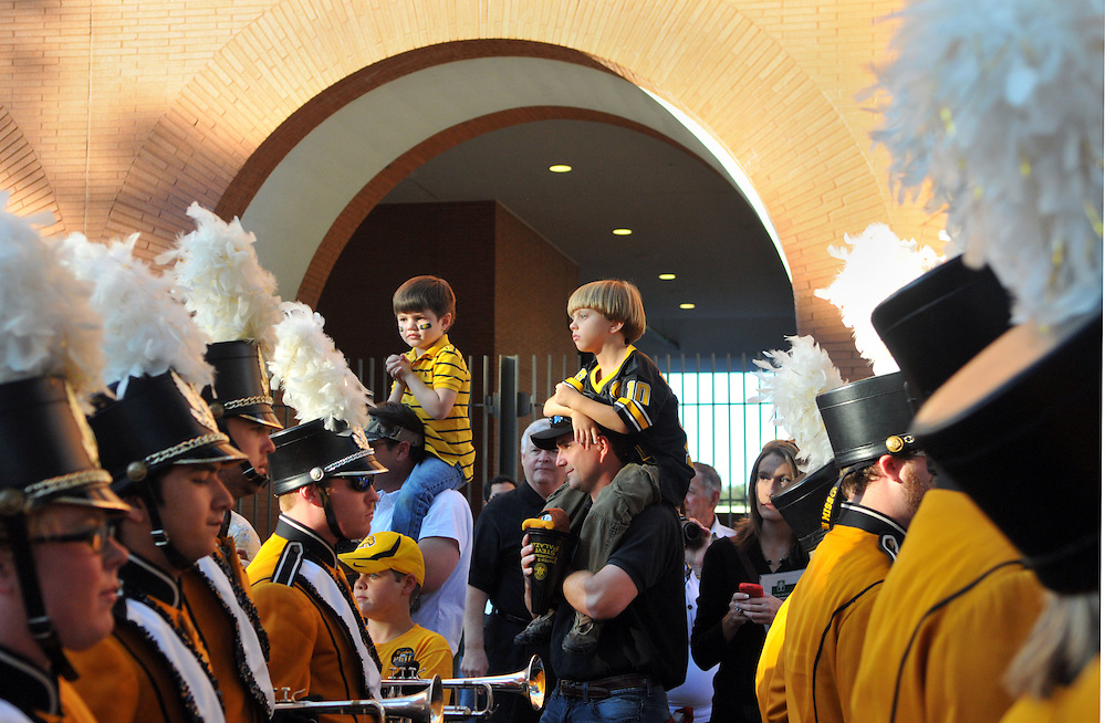 USM fans watch members of the Pride of Southern Mississippi Marching Band perform during the homecoming Eagle Walk Saturday. Bryant Hawkins/ Hattiesburg American
