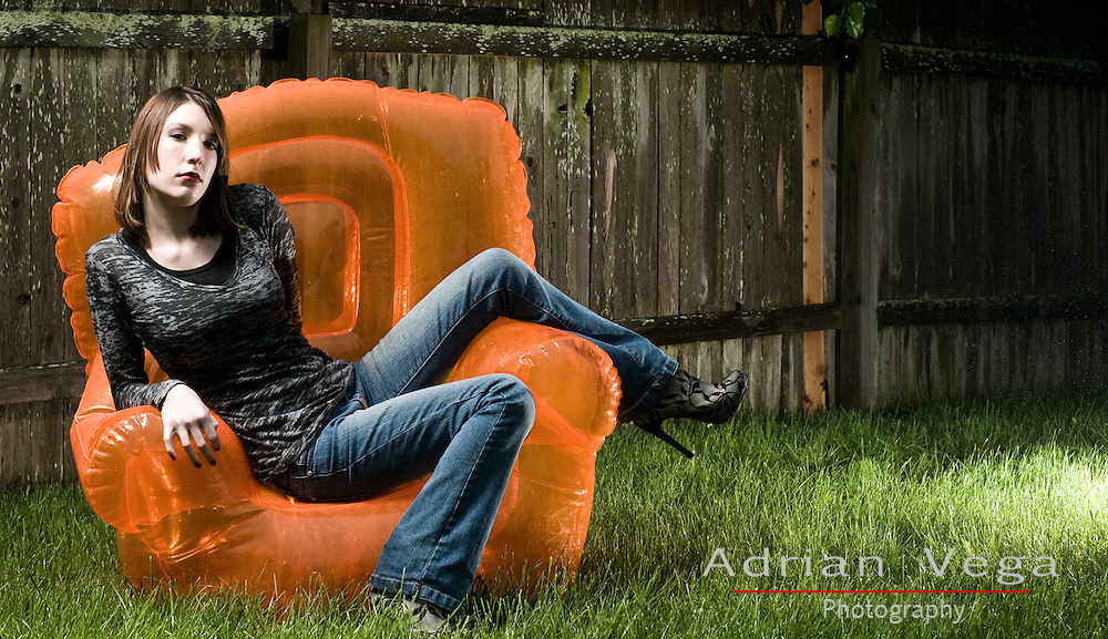 Senior portrait of model outdoors. Lawn portrait with bright chair.Lees Summit Missouri