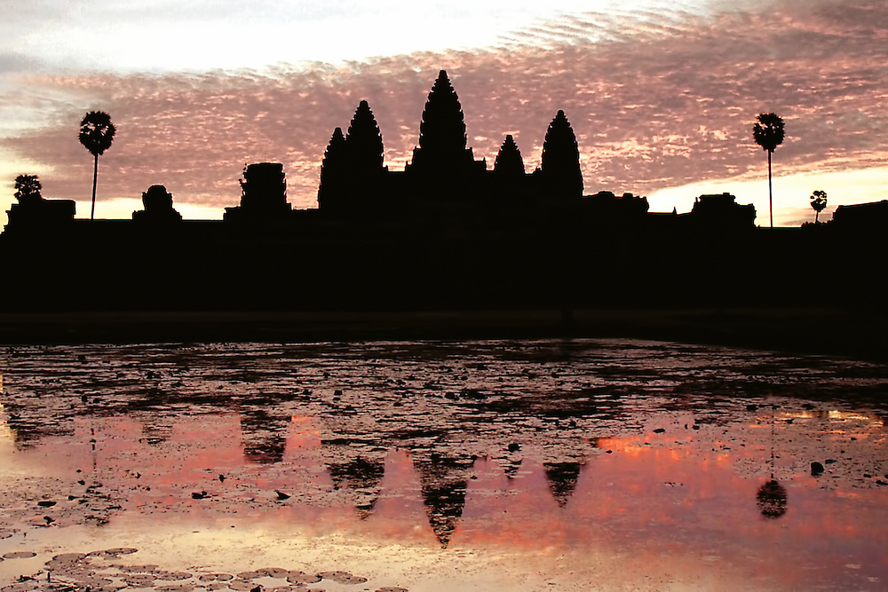 Angkor Wat - Reflections<br /> The five towers of Angkor Wat are shaped like Lotus Flowers and look spectacular against the setting sun, which symbolises the passing from earth to heaven.
