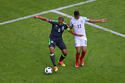 LENS, FRANCE - Thursday, June 16, 2016: Wales' captain Ashley Williams in action against England's Marcus Rashford during the UEFA Euro 2016 Championship Group B match at the Stade Bollaert-Delelis. (Pic by Paul Greenwood/Propaganda)