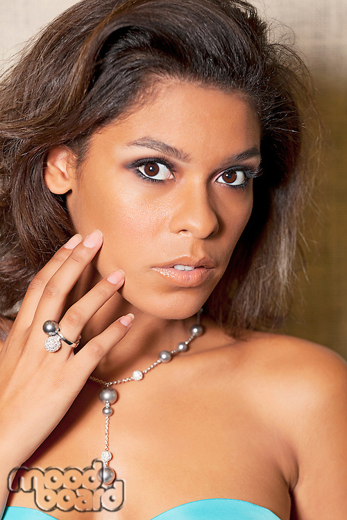 Portrait of young multi ethnic woman posing with beautiful jewelry