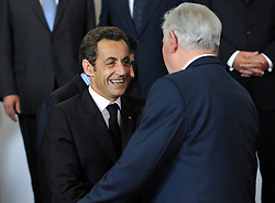 "Nicolas Sarkozy, France's president, left, greets his colleagues, during the ""Family Photo"" session at the European Summit, in Brussels, Belgium, Wednesday, Oct. 15, 2008.   (Photo © Jock Fistick)"