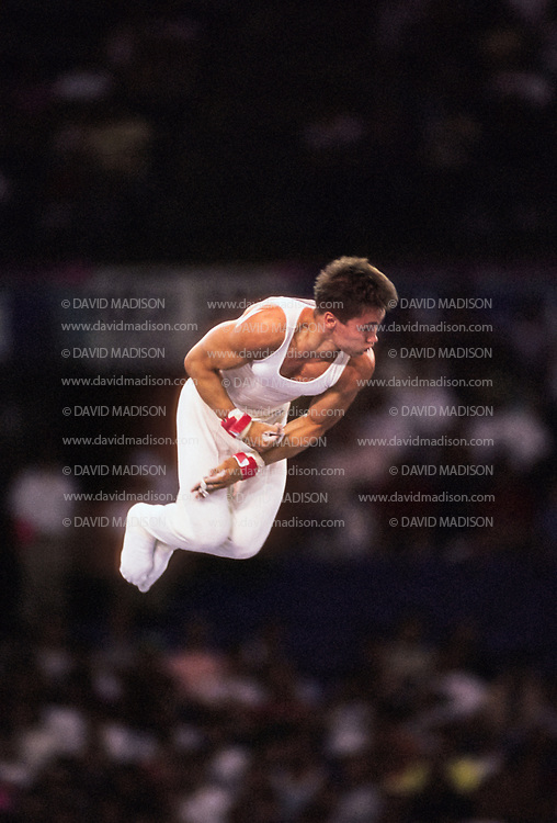 SEATTLE - JULY 1990:  Csaba Fajkusz of Hungary performs on the high bar during the Men's Gymnastics competition of the 1990 Goodwill Games held from July 20 - August 5, 1990.  The gymnastics venue was the Tacoma Dome in Tacoma, Washington.  (Photo by David Madison/Getty Images)