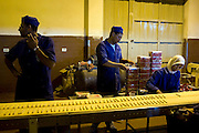 "A skeleton crew of Palestinian workers mans a reduced production line at the Al Awda factory for biscuits and ice cream in Deir Al-Bala camp August 02, 2007 in Gaza. The United Nations is warning of ""disasterous consequences"" as up to 80% of Gaza factories have either closed or been forced to reduce staff because of border closings with Israel aimed at politically and economically pressuring Hamas. The Al-Awda factory usually employs 200 workers but has been forced to reduce that by half recently. Also, 50-60% of the factory's output is usually exported to the West Bank, menaing since the closure of the crossings the factory is losing thousands of dollars daily..."