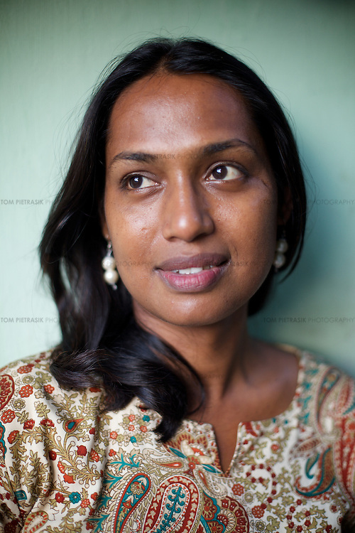 Kalki Subramaniam an activist for the rights of transgenders in Chennai. ..India's transexual community has a recorded history of more than four thousand years. Many consider the The Third Sex, also known as Aravanis, to posses special powers allowing them to determine the fate of others. As such, they are not only revered but despised and feared too. Resigned to the fringes of society, segregated and excluded from most occupations, many Aravanis are forced to turn to begging and sex work in order to earn a living. ..The annual transgender festival in the village of Koovagam, near Vilappuram, offers an escape from this often desolate existence. For some, the week-long partying and frenetic sex trade that culminates in the Koovagam festival is about fulfilling lustful desires. For others, the gathering provides a chance for transgenders to bond, share experiences, join the wider homosexual gay-community and coordinate their campaign for recognition and tackle the challenge of HIV/AIDS. ..It is the Indian state of Tamil Nadu that the eighty-thousand-strong Aravani community has made advances in their fight for rights. In 2009, the Tamil Nadu state government began providing sex-change surgery free of cost. The state has also offers special third-gender ration cards, passports and reserved seats in colleges. And 2008 the launch of Ippudikku Rose, a Tamil talk-show fronted by India's first transgender TV-host and the release of a mainstream Tamil film staring an Aravani in the lead-role. ..These advances clearly signal a victory for south India's transgenders, but they have also exposed deep divisions within the community. There is a very real gulf that separates the majority poor from their potentially influential but often reticent, upper-class sisters. ..Photo: Tom Pietrasik.Chennai, Tamil Nadu. India.May 2009